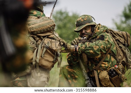 russian paratrooper airborne infantry in the forest - stock photo