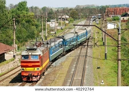 russian passenger train entering station - stock photo