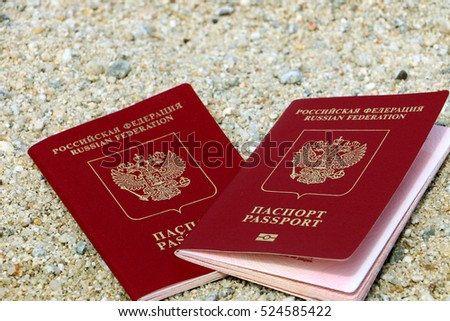 Russian passports on the beach. Travel concept
