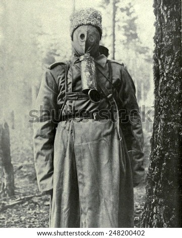 Russian primitive type of gas mask used in WW1. 1917. The rubber mask covers the face and the soldier breaths through a hole on top of the tin which is filled with charcoal and chemicals.