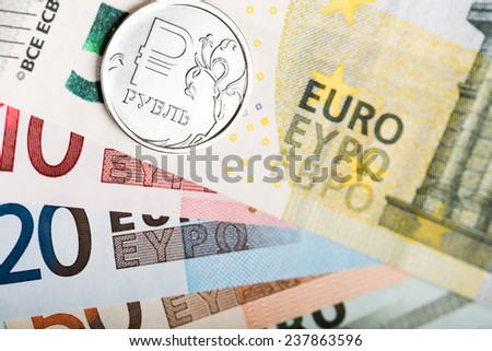 russian ruble coin on the European banknotes