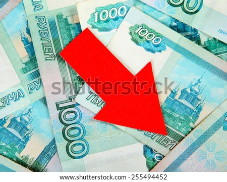 Russian Rubles and Red Arrow Down closeup - stock photo
