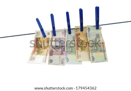 Russian rubles banknotes hanging on laundry line attached with plastic clothespins against white background - stock photo