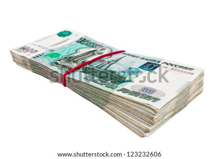 Russian rubles wrapped by rubber on white background
