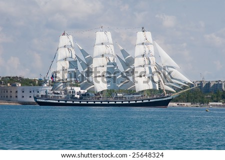 Russian sailboat entering to Sevastopol bay - stock photo