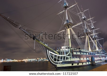 Russian ship in the night lights and bridge on background, St. Petersburg, Russia - stock photo
