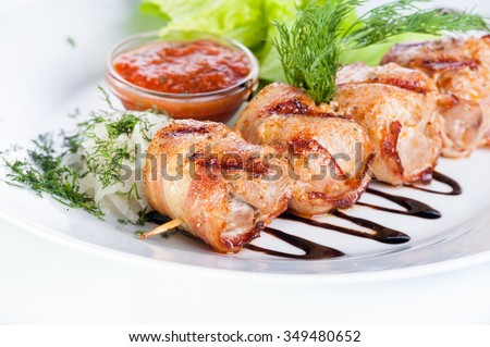 Russian skewers with parsley, onion and lettuce on a white background