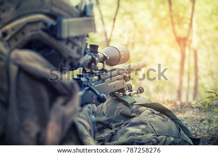 Russian sniper - rear view Sniper with rifle hidden in trench, stealth warrior, precise shoot, Infantry soldier shooting during military combat training.