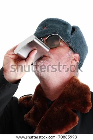 Russian soldier drinking vodka from flask