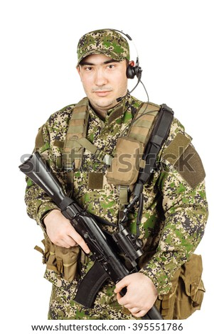 Russian soldier in camouflage with rifle. Isolated on white background