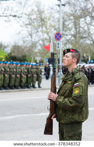 Russian soldier with gun on parade in honor of the victory Crimea, Sevastopol 9 May 2015,Victory Day parade - stock photo