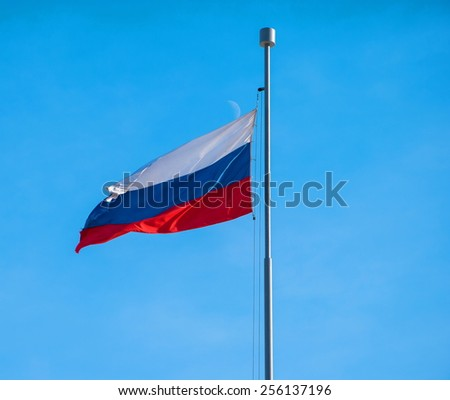 Russian state flag on a background of the sky