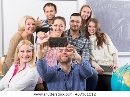 russian students of different age doing group selfie on smartphone