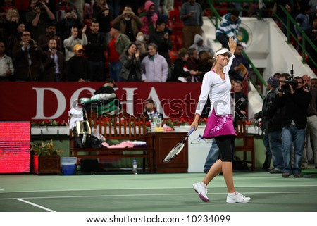 Russian tennis superstar Maria Sharapova waves to fans after her victory in the semi-final of the Qatar Total Open 2008. She went on to win the tournament for the second time. - stock photo