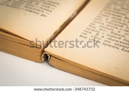 Russian text book open aged background