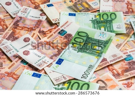 Russian 5 thousand and Euro 50 and 100 money banknotes background - stock photo