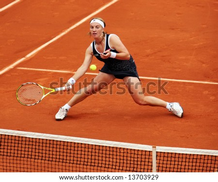 Russian top tennis player and world #4 Svetlana Kuznetsova plays net volley during her match at French Open 2008, Roland Garros. Paris, France. - stock photo