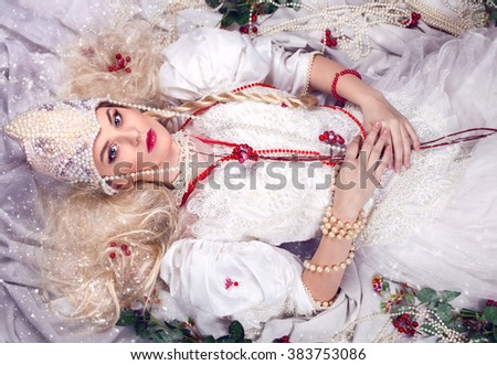 Russian traditional fairy tale costume. Fashion beautiful spring bride blonde caucasian woman - stock photo