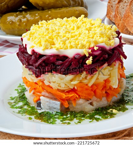 Russian traditional herring salad - stock photo
