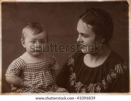 Russian vintage photograph, beginning of XX century. Family. Young woman and baby - stock photo