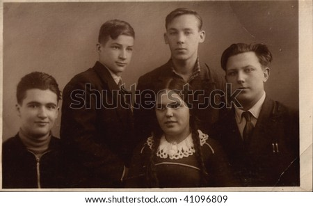 Russian vintage photograph, beginning of XX century. four youths of man and girl - stock photo