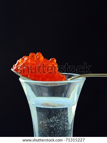 Russian vodka with  red caviar traditional appetizer - stock photo