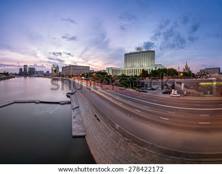Russian White House and Krasnopresnenskaya Embankment in the Evening, Moscow, Russia - stock photo