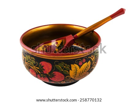 Russian wooden round bowl with a spoon painted Khokhloma, isolated on white background.