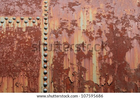 Rust and rivets on the side of an old turbine. - stock photo