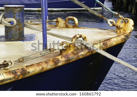 Rust at a glance: Oxidizing bow of fishing trawler in harbor - stock photo