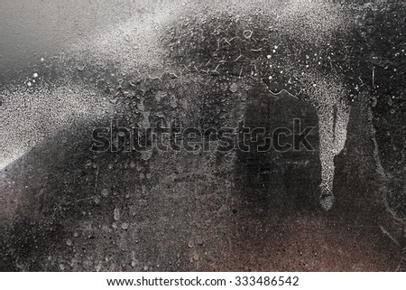Rust-covered fence  with dripping black and white paint -  grunge iron textured abstract background - stock photo