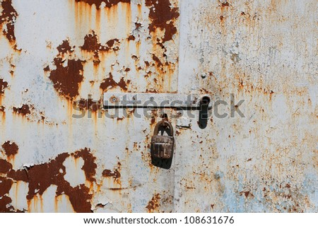 rust, paint and old lock - stock photo