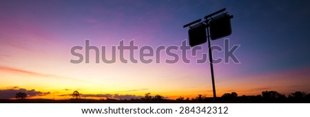 Rusted fuel station silhouette sign in the outbacks of Brisbane, Queensland. - stock photo