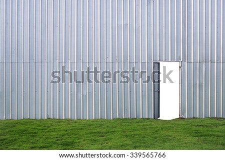 Rusted galvanized iron plate with leaves green floor and open door on white background - stock photo