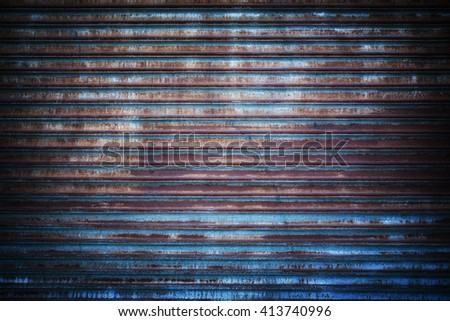 Rusted metal grille background with traces of old blue paint.  - stock photo