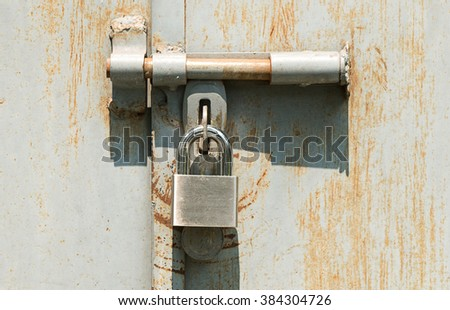 Rusted metal lock key texture or background - stock photo