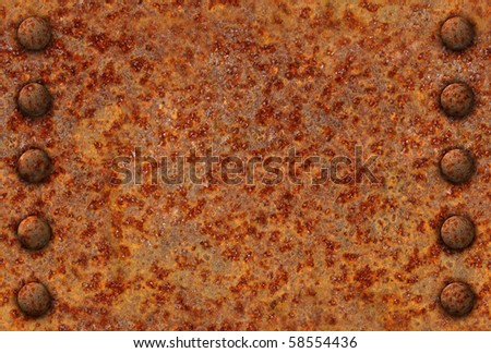 Rusted metal surface with rivet bolts seamlessly tileable - stock photo