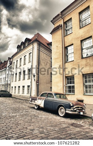 Rusted old car in the streets of Old Tallinn - stock photo