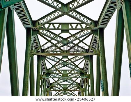 Rusted old iron trellis bridge. Abstract details. - stock photo