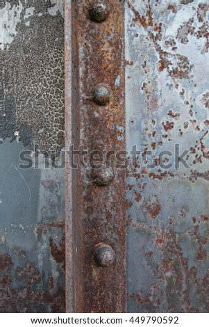 Rusted Rivets in Angle Iron background image - stock photo