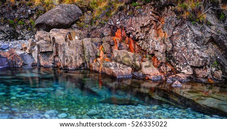 Rusted rocks in Fairy Pools, Glen Brittle, Isle of Skye, Inner Hebrides, Highlands, Scotland