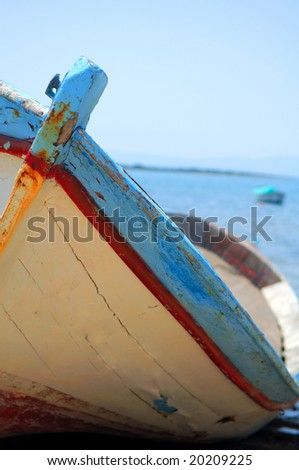 Rusted rowboat beached at Cesme, Turkey