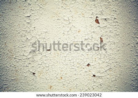 Rusted white metal wall with cracks on paint, background texture with vintage toned photo filter effect, instagram style - stock photo