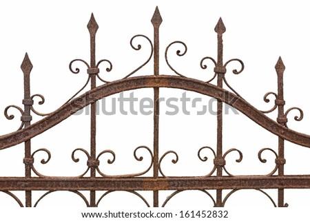 Rusted wrought iron fence on white background - stock photo