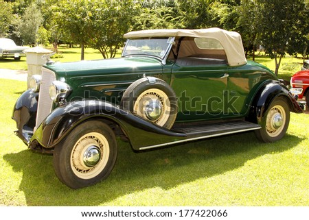 RUSTENBURG, SOUTH AFRICA - FEBRUARY 15:  Green 1934 Chevrolet Roadster Passenger Side View in Private Collection Philip Classic Cars on February 15, 2014 in Rustenburg South Africa.    - stock photo