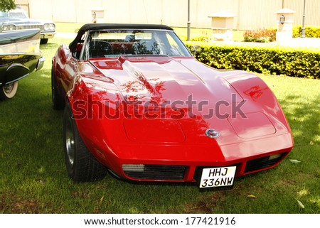 RUSTENBURG, SOUTH AFRICA - FEBRUARY 15:  Red 1973 Chevrolet Stingray Corvette Front View in Private Collection Philip Classic Cars on February 15, 2014 in Rustenburg South Africa.    - stock photo