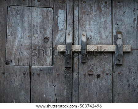 Rustic and old wooden gate background