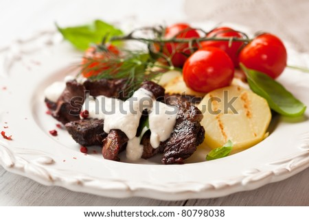 Rustic beef dish with cherry tomatoes