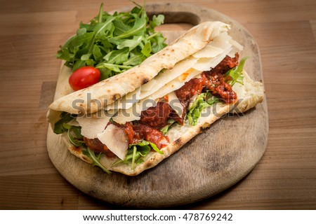 rustic bread focaccia ciabatta filled sandwich Italian wood fired oven beef meatballs Parmesan rocket salad tomato sauce on wooden plate board