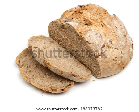 Rustic bread loaf with slices cut. - stock photo